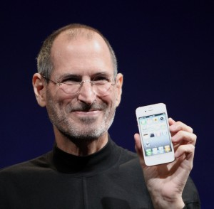 Steve Jobs holding an iPhone: The great tech dictator?