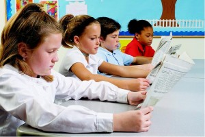 Kids reading newspapers at wRanter.com